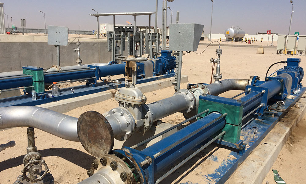 PCM multiphase boosting pumps for reducing high oil wellhead pressure